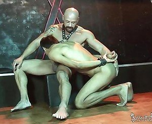Hunky twink slave gives head to a mature SM s